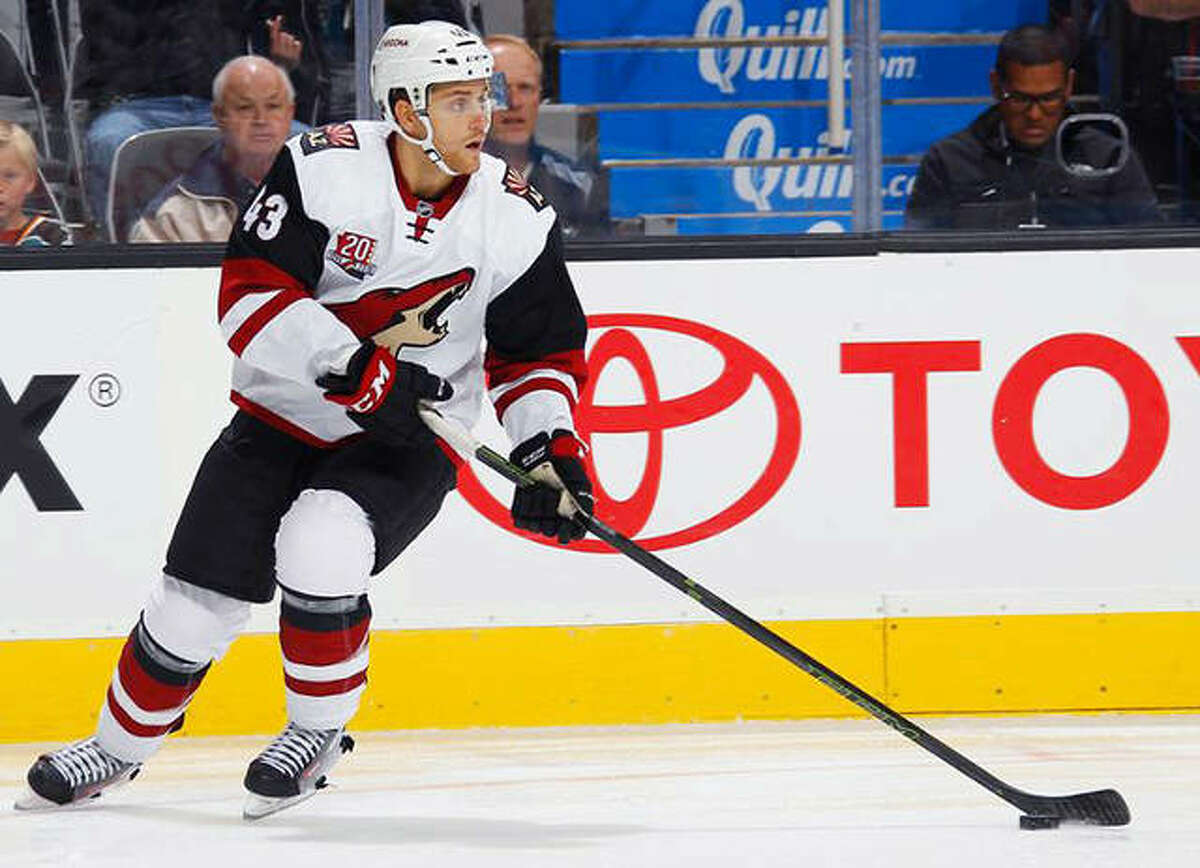 Alton native Dakota Mermis has signed a free agent contract with the New Jersey devils of the National Hockey League. Mermis, a graduate of Alton High and former Telegraph Player of the Year, had been with the Arizona Coyotes organization the past three seasons. He is is shown playing for Arizona during a 2018 game in Boston.