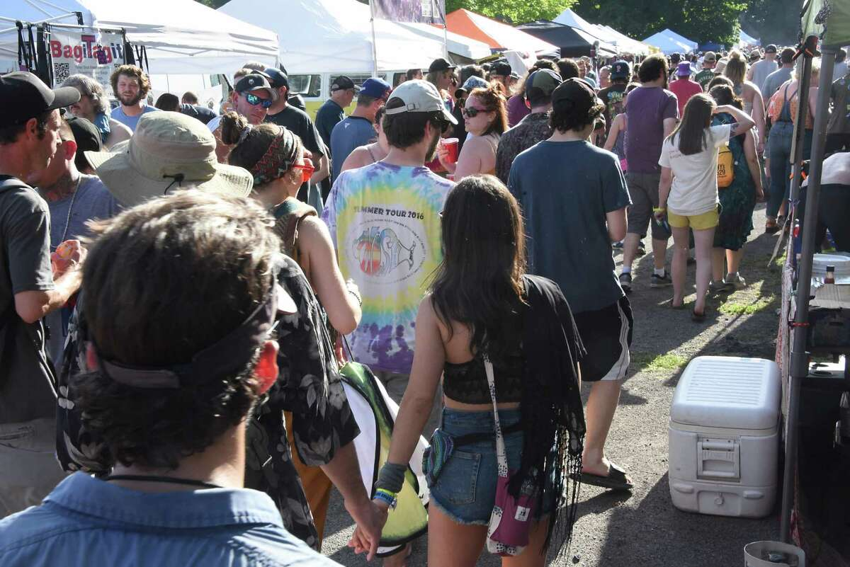People walk through Shakedown Street a couple hours before Phish performs at the Saratoga Performing Arts Center on Tuesday, July 2, 2019 in Saratoga Springs, N.Y. This is the first show of a two-day stop. (Lori Van Buren/Times Union)