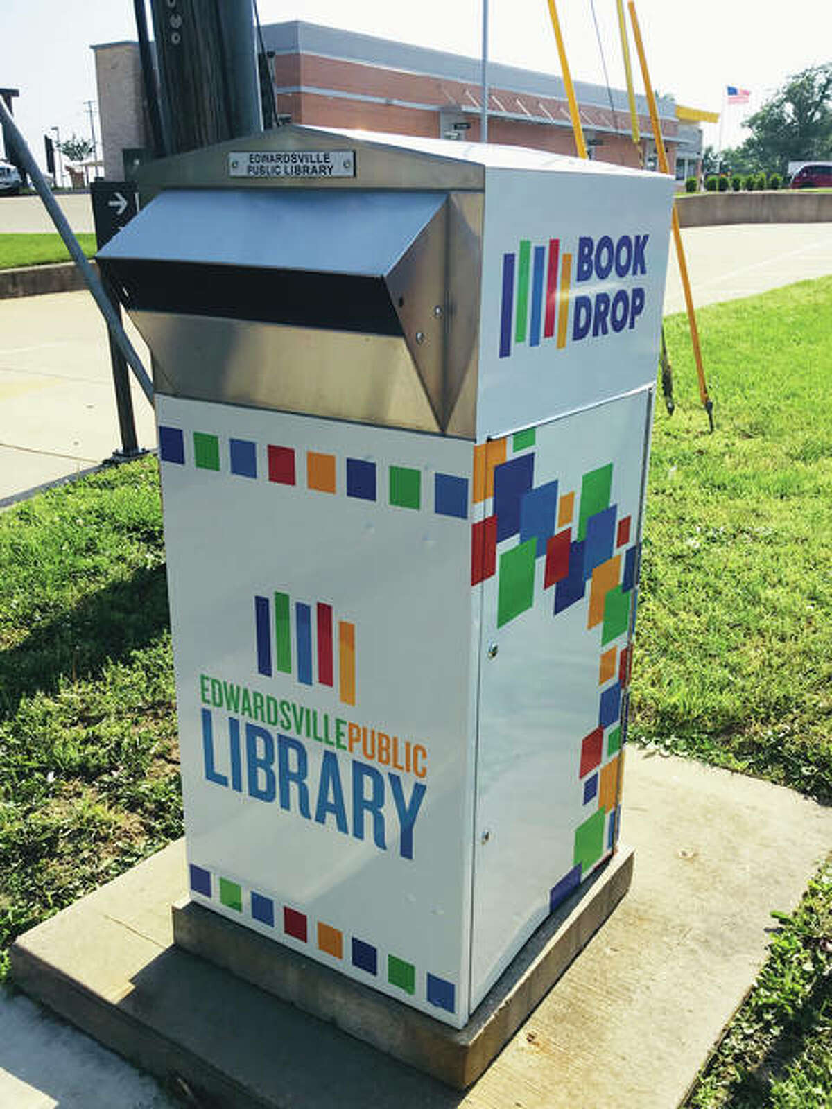 The Edwardsville Public Library's Montclaire book drop features a new vinyl wrap imprinted with the library's new logo. The library has five book drops located in the city of Edwardsville, making it more convenient for patrons to return material.