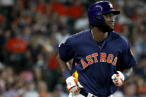 Houston Astros designated hitter Yordan Alvarez (44) smiles at Seattle Mariners Mike Wright Jr. as he was intentionally walked during the seventh inning of an MLB baseball game at Minute Maid Park, Sunday, June 30, 2019, in Houston.
