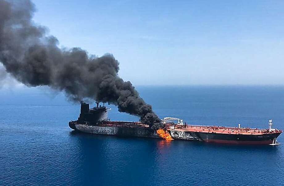 A picture obtained by AFP from Iranian News Agency ISNA on June 13, 2019 reportedly shows fire and smoke billowing from Norwegian owned Front Altair tanker said to have been attacked in the waters of the Gulf of Oman. - Suspected attacks left two tankers in flames in the waters of the Gulf of Oman today, sending world oil prices soaring as Iran helped rescue stricken crew members. The mystery incident, the second involving shipping in the strategic sea lane in only a few weeks, came amid spiralling tensions between Tehran and Washington, which has pointed the finger at Iran over earlier tanker attacks in May. (ISNA/AFP/Getty Images/TNS) **FOR USE WITH THIS STORY ONLY** Photo: (ISNA/AFP/Getty Images), TNS