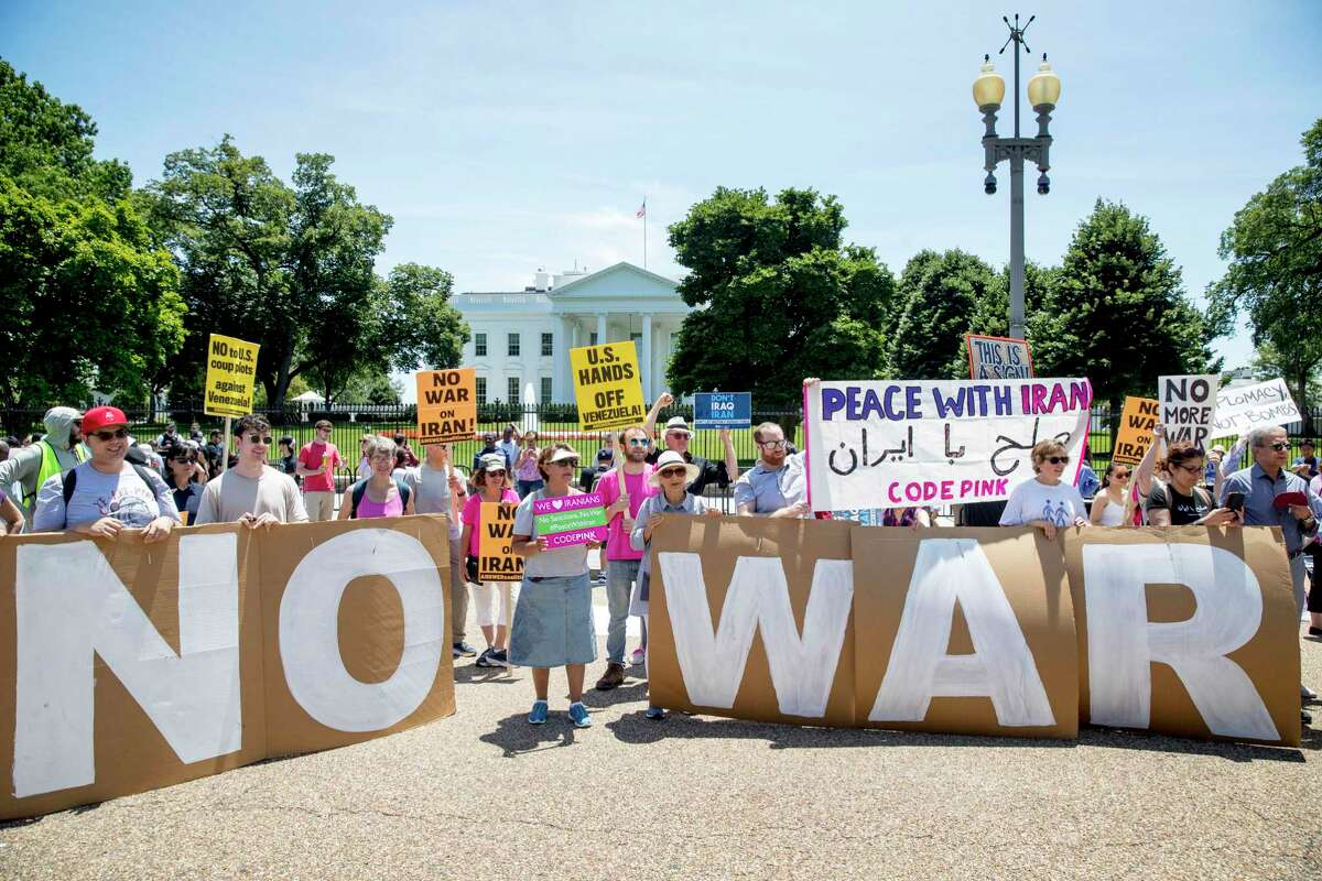 Members of the ANSWER Coalition hold a June 23 anti-war with Iran rally outside the White House.
