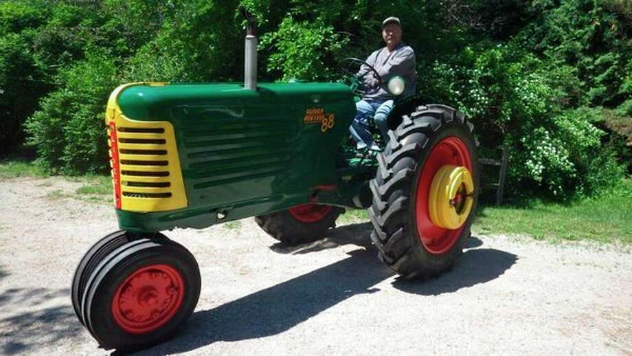 Tom Lounsbury sits on his refurbished vintage (1953) Oliver tractor that he's been using since he was a farm kid. (Photo provided by Tom Lounsbury)