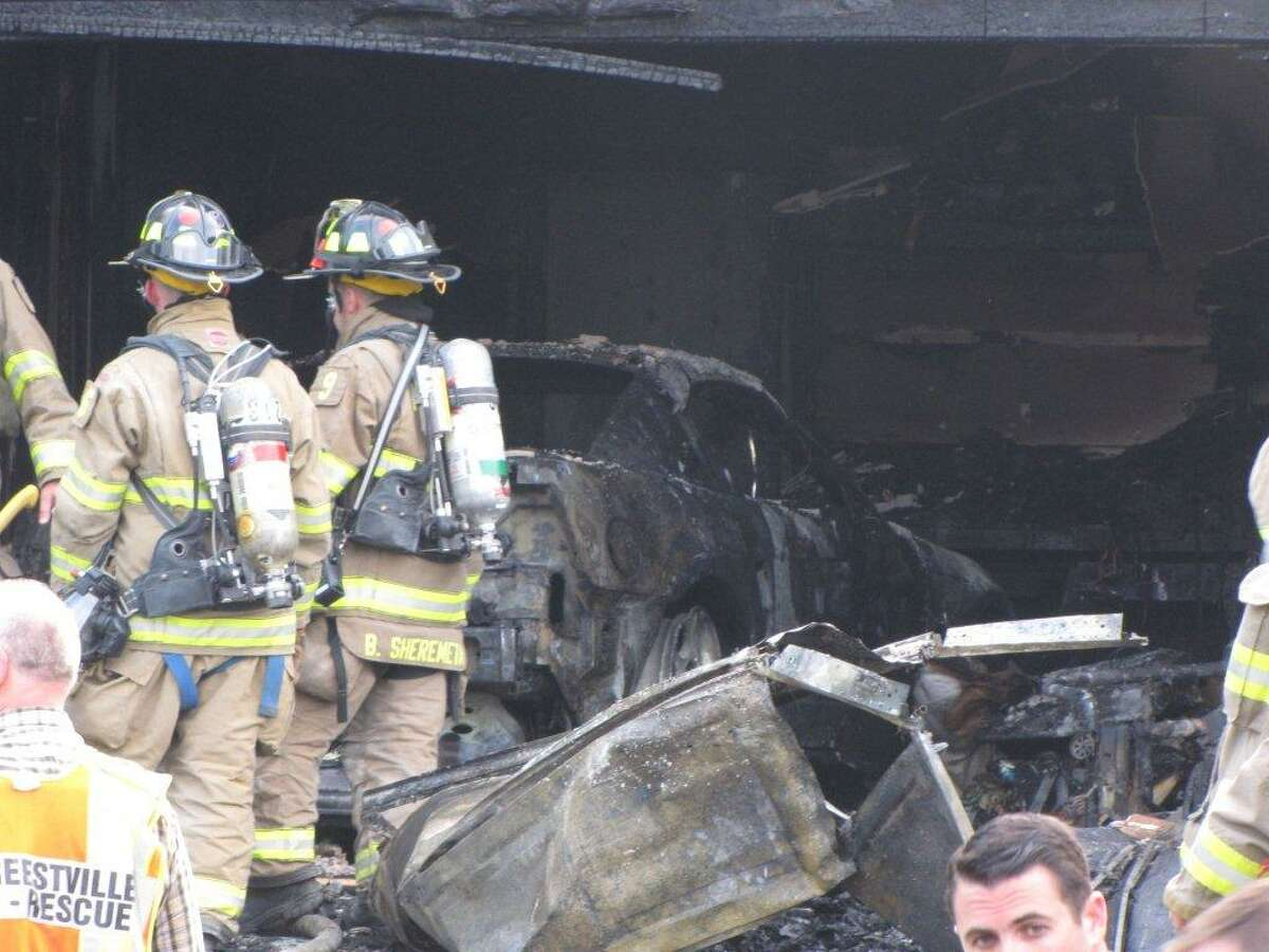An attached garage was heavily damaged by smoke and flames on Tuesday eveningin North Greenbush. (Marty Miller)