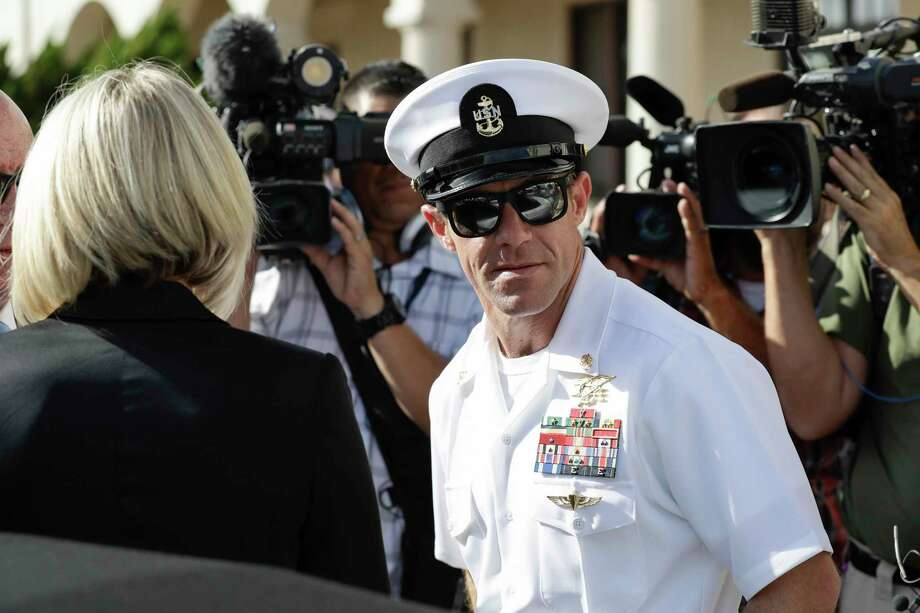 Navy Special Operations Chief Edward Gallagher, right, and his wife, Andrea Gallagher leave a military court on Naval Base San Diego, Tuesday, July 2, 2019, in San Diego. A military jury acquitted a decorated Navy SEAL of premeditated murder Tuesday in the killing of a wounded Islamic State captive under his care in Iraq in 2017. (AP Photo/Gregory Bull) Photo: Gregory Bull, STF / Associated Press / Copyright 2019 The Associated Press. All rights reserved.