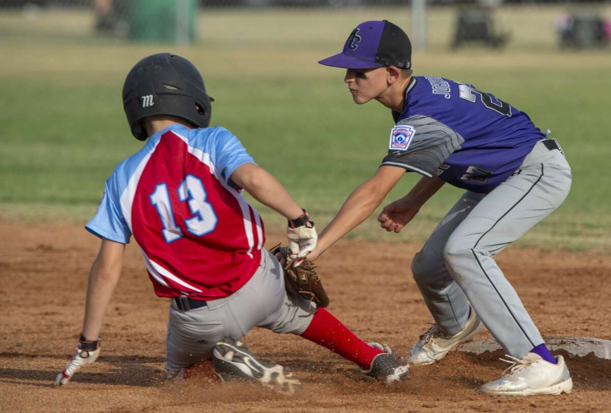 Mid City All Stars' Cooper Johnston puts the tag on Lubbock Southwest's JJ Villalobos attempted steal at second 07/02/19 during the 11 and under Section 1 Tournament at James P. Butler Park. Tim Fischer/Reporter-Telegram