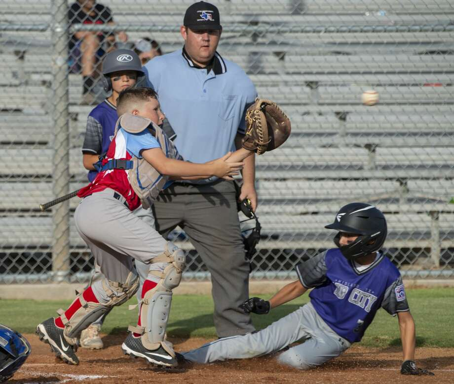 Lubbock Southwest catcher JJ Villalobos reaches for the ball as Mid City All Star Caden Martin safely slides into home 07/02/19 during the 11 and under Section 1 Tournament at James P. Butler Park. Tim Fischer/Reporter-Telegram Photo: Tim Fischer/Midland Reporter-Telegram