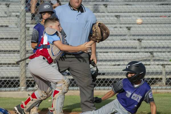 Lubbock Southwest catcher JJ Villalobos reaches for the ball as Mid City All Star Caden Martin safely slides into home 07/02/19 during the 11 and under Section 1 Tournament at James P. Butler Park. Tim Fischer/Reporter-Telegram