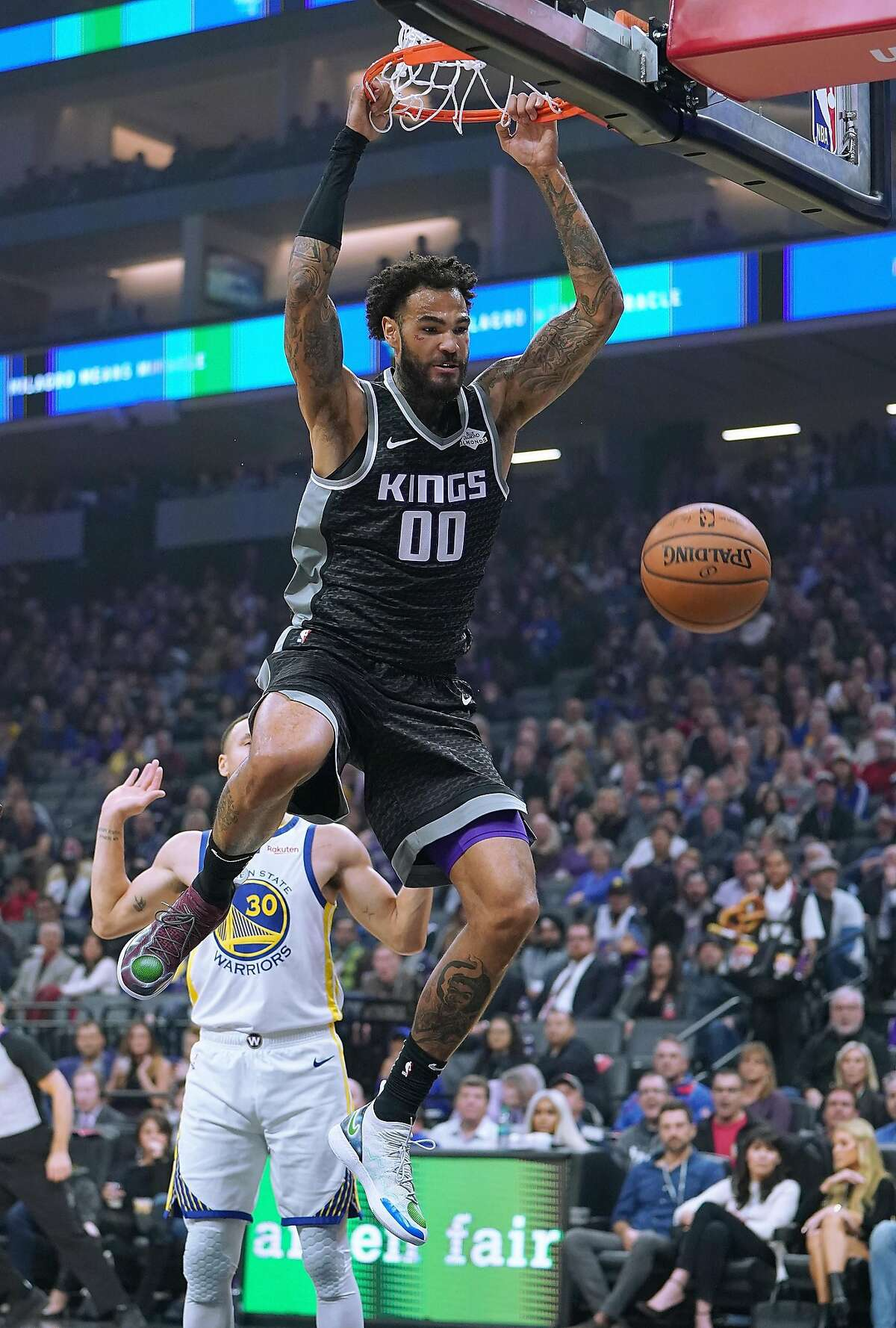 FILE - Willie Cauley-Stein of the Sacramento Kings goes up for a slam dunk against the Golden State Warriors during an NBA basketball game at Golden 1 Center on December 14, 2018 in Sacramento, California. Cauley-Stein agreed to sign with the Warriors last week in what's been a busy offseason for the Dubs.