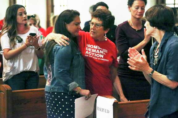 Rena Castro is consoled by Linda Wilson, right, after delivering an emotional account of the death of her daughter, Erin Rios Castro, last year. They attended a town hall meeting July 2, 2019, with U.S. Reps. Joaquin Castro and Lloyd Doggett about the domestic violence problem in Bexar County.