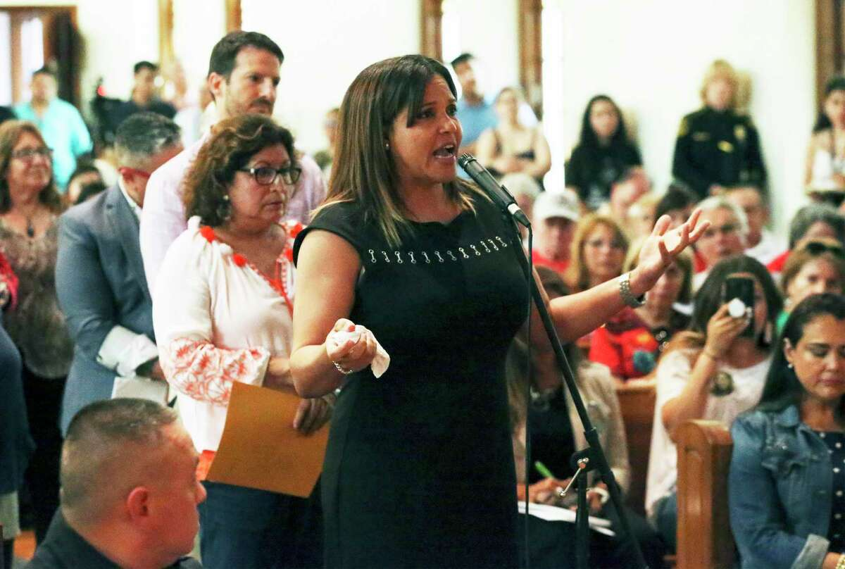 Lillian Morales appeals for help from law enforcement members on the panel of a town hall meeting July 2, 2019, with U.S. Reps. Joaquin Castro and Lloyd Doggett about the domestic violence problem in Bexar County.