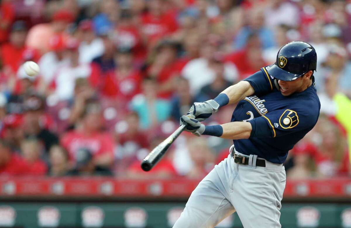Milwaukee Brewers' Christian Yelich (22) hits a solo home run off Cincinnati Reds starting pitcher Tanner Roark during the fourth inning of a baseball game, Tuesday, July 2, 2019, in Cincinnati. (AP Photo/Gary Landers)