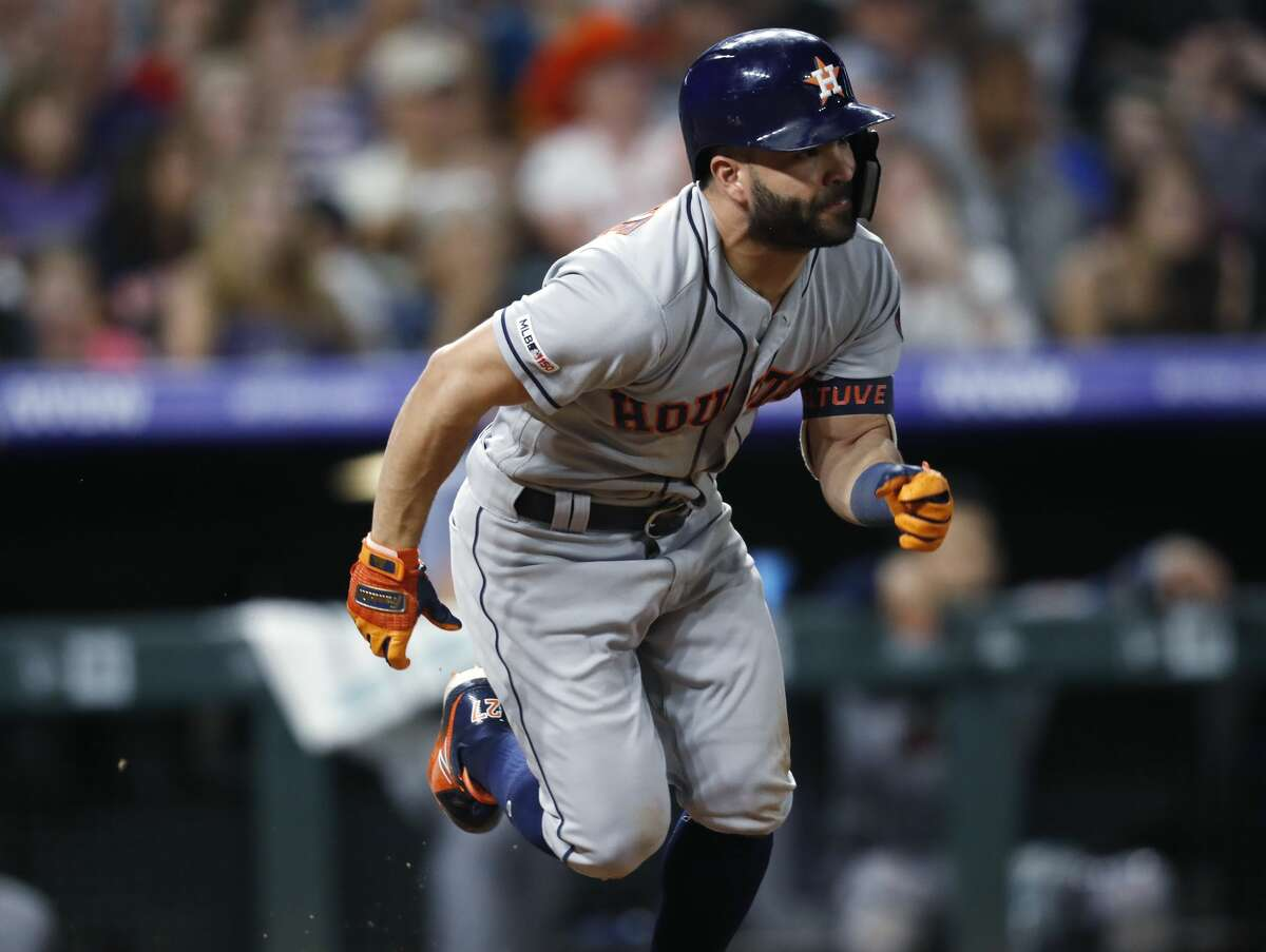 Houston Astros' Jose Altuve heads up the first-base line ater singling off Colorado Rockies relief pitcher Scott Oberg in the ninth inning of a baseball game Tuesday, July 2, 2019, in Denver. The Astros won 9-8. (AP Photo/David Zalubowski)
