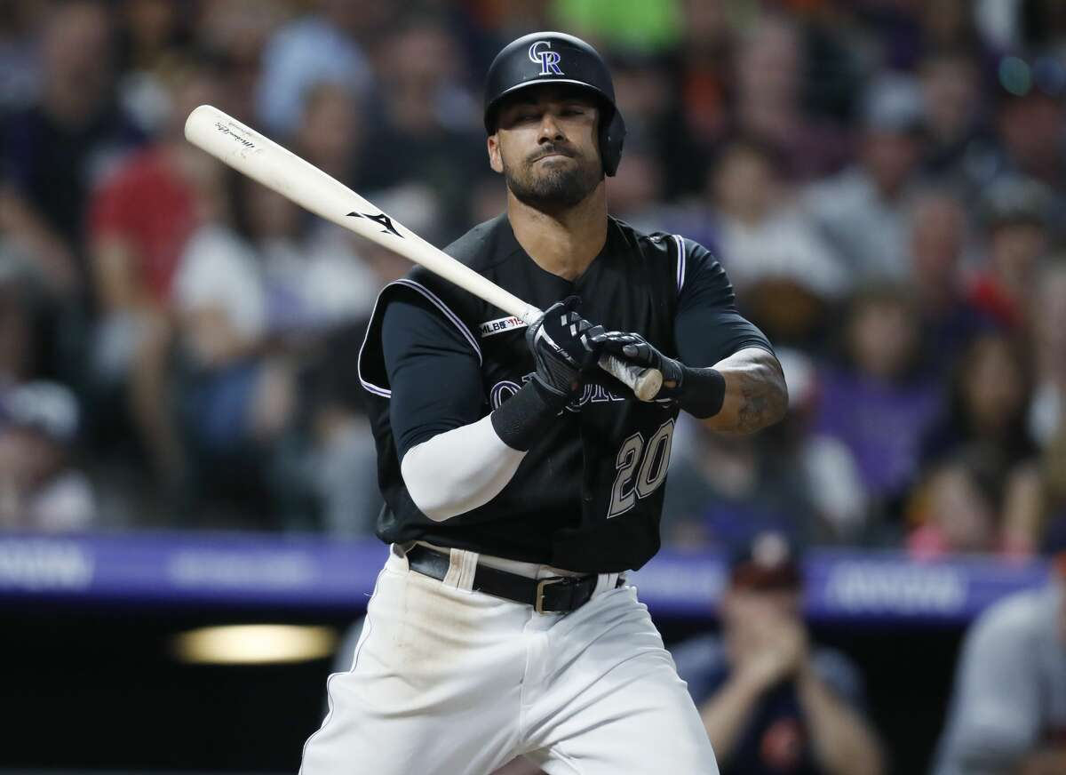 Colorado Rockies' Ian Desmond reacts as he strikes out against Houston Astros relief pitcher Roberto Osuna in the ninth inning of a baseball game Tuesday, July 2, 2019, in Denver. The Astros won 9-8. (AP Photo/David Zalubowski)