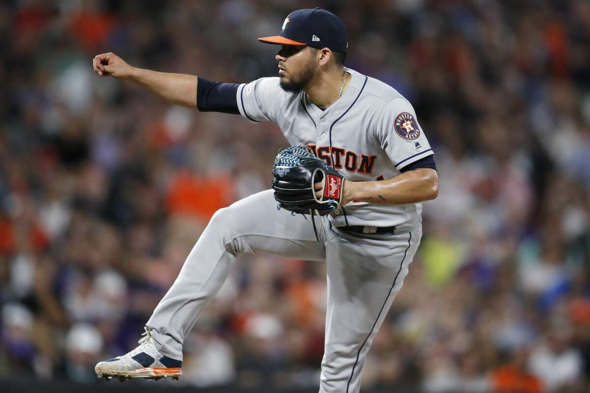 Houston Astros relief pitcher Roberto Osuna works against the Colorado Rockies in the ninth inning of a baseball game Tuesday, July 2, 2019, in Denver. The Astros won 9-8. (AP Photo/David Zalubowski)