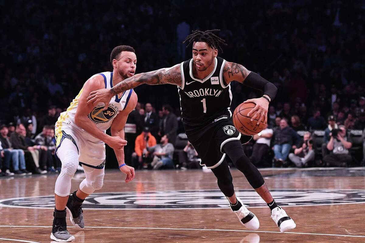 D'Angelo Russell #1 of the Brooklyn Nets drives to the basket against Stephen Curry #30 of the Golden State Warriors during the game at Barclays Center on October 28, 2018 in the Brooklyn borough of New York City.