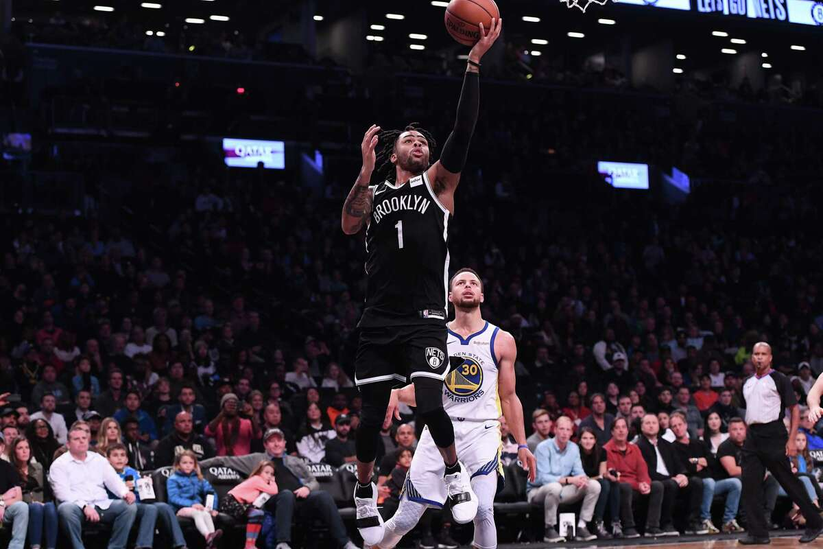 D'Angelo Russell #1 of the Brooklyn Nets lays up a shot against Stephen Curry #30 of the Golden State Warriors during the game at Barclays Center on October 28, 2018 in the Brooklyn borough of New York City.