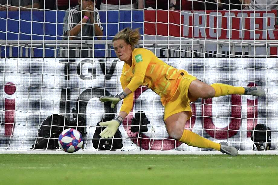 United States' goalkeeper Alyssa Naeher saves a penalty kick during the France 2019 Women's World Cup semi-final football match between England and USA, on July 2, 2019, at the Lyon Satdium in Decines-Charpieu, central-eastern France. (Photo by Jean-Pierre Clatot / AFP)JEAN-PIERRE CLATOT/AFP/Getty Images Photo: JEAN-PIERRE CLATOT / AFP/Getty Images / AFP or licensors