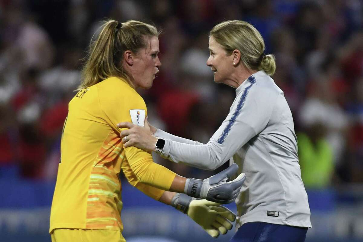 United States' coach Jillian Ellis, right, celebrates with goalkeeper Alyssa Naeher at the end of a semifinal match against England on July 2.