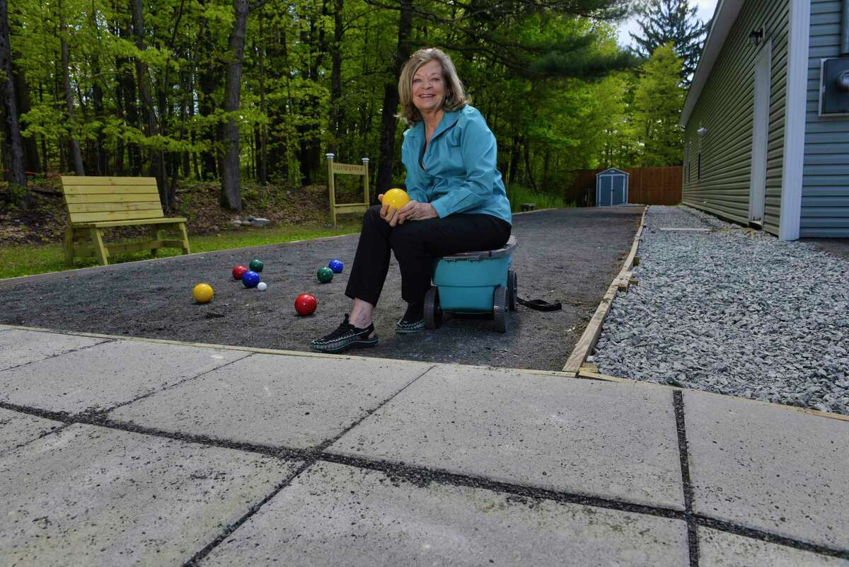 Mary Ellen Whitney, founder and CEO of Stride Adaptive Sports, at the bocce court outside the future home of the SHARE Center on Thursday, May 16, 2019, in West Sand Lake, N.Y. The professional bocce court was built with a wheel chair pad to accommodate all players. (Paul Buckowski/Times Union)