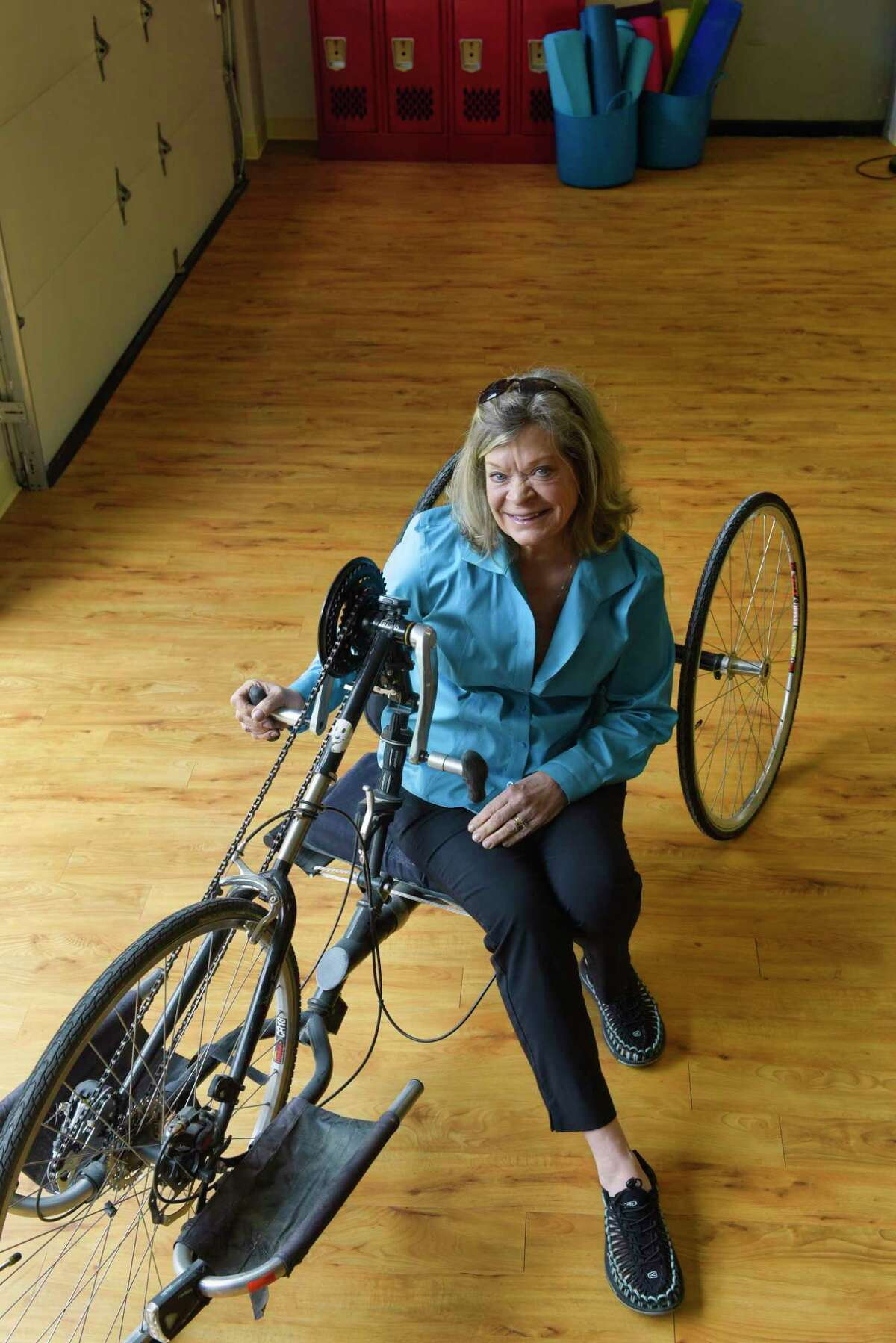 Mary Ellen Whitney, founder and CEO of Stride Adaptive Sports sits on a hand cycle in the gym that will be the future home of the SHARE Center on Thursday, May 16, 2019, in West Sand Lake, N.Y. A hand cycle is a bicycle for people who use wheelchairs. (Paul Buckowski/Times Union)