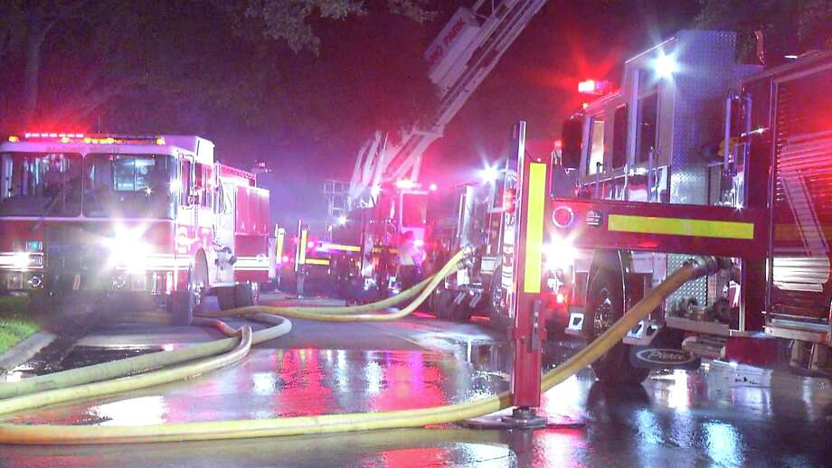 Two firefighters were treated for burns while battling a blaze in the 200 block of Honeysuckle Lane. Photo: Ken Branca