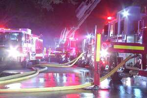 Two firefighters were treated for burns while battling a blaze in the 200 block of Honeysuckle Lane.
