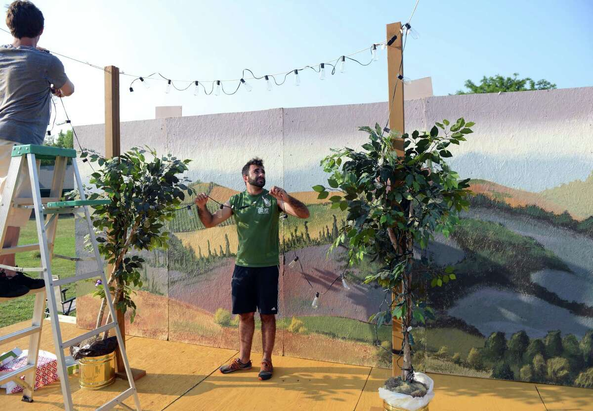 """Tom Simonetti, director of the Valley Shakespeare Festival, sets up the stage in 2014 at Veteran's Memorial Park in Shelton, for """"Much Ado About Nothing."""""""