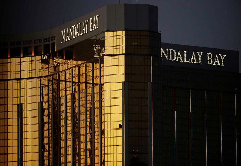 In this Oct. 3, 2017, file photo, windows are broken at the Mandalay Bay resort and casino in Las Vegas, the room from where Stephen Craig Paddock fired on a nearby music festival, killing 58 and injuring hundreds on Oct. 1. Casino giant MGM Resorts International says more than 4,000 people are seeking compensation related to the Las Vegas Strip shooting that left 58 people dead, and it's suing its insurance company for legal costs. A lawsuit filed Wednesday, June 19, 2019 in U.S. District Court in Las Vegas alleges breach-of-contract by Illinois-based Zurich American Insurance Co. Photo: John Locher / Associated Press / Copyright 2017 The Associated Press. All rights reserved.
