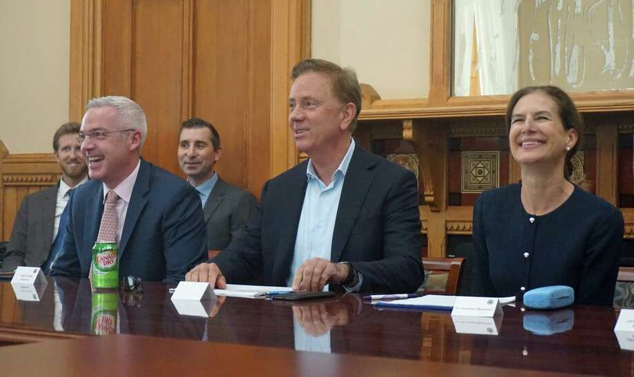 Gov. Ned Lamont (center), Lamont Chief of Staff Ryan Drajewicz (left) and Lieutenant Gov. Susan Bysiewicz (right) spoke at a meeting with Democrat and Republican legislative leaders about tolling and Connecticut's transportation infrastructure needs at the Capitol in Hartford, Conn. on Wednesday June 19, 2019. Photo: Emilie Munson / Hearst Connecticut Media / Connecticut Post