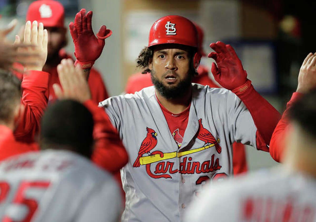 The Cardinals' Jose Martinez is greeted in the dugout after he hit a solo home run against the Mariners during the sixth inning Tuesday night in Seattle.