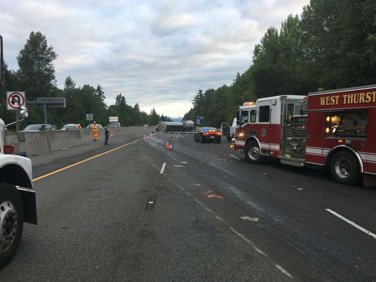 Northbound lanes of Interstate 5 were closed Wednesday morning after a tanker carrying 4,000 gallons of used motor oil overturned near the Lewis/Thurston County Line.