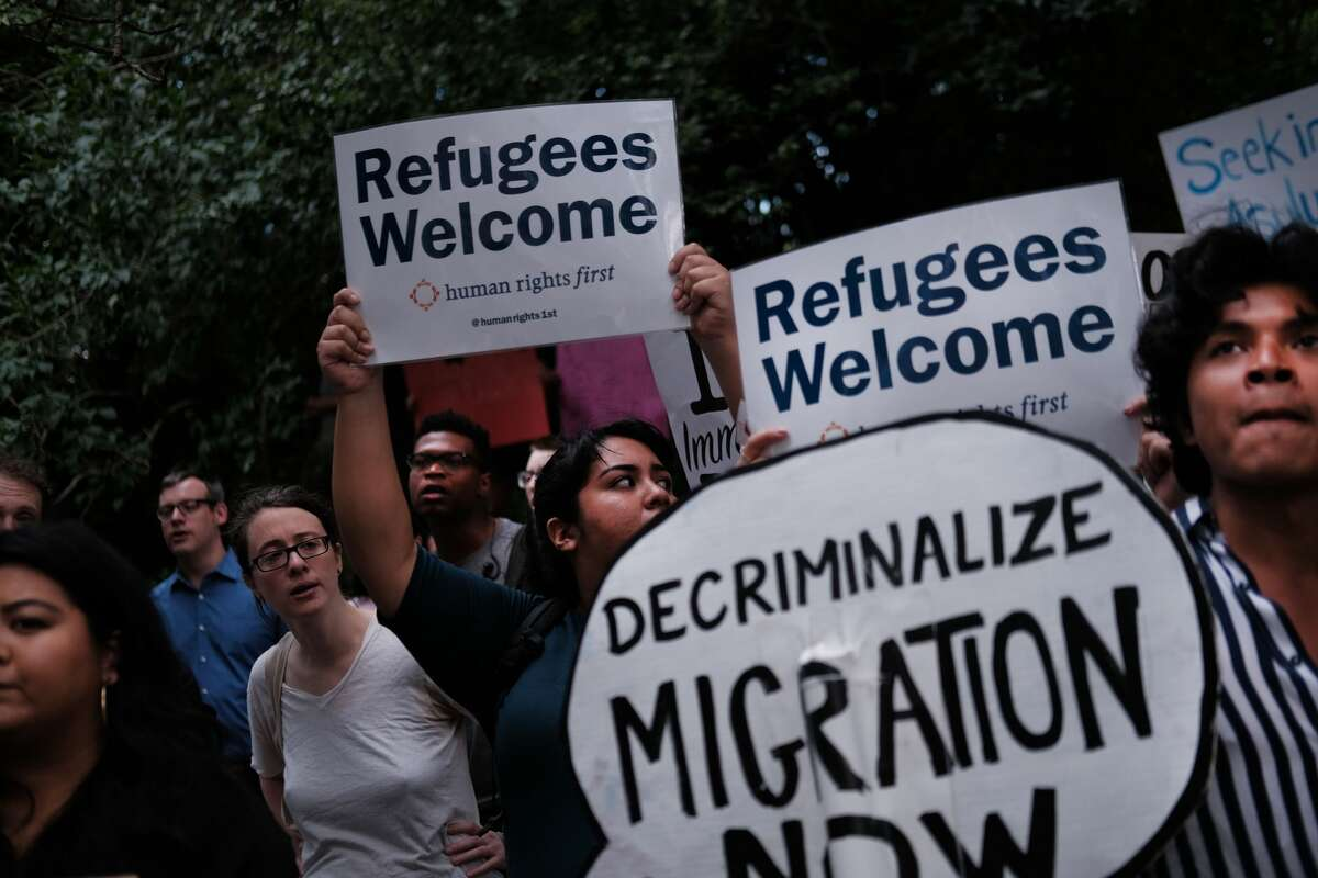 Hundreds of people gather in front of U.S. Senator Chuck Schumer's Brooklyn apartment to protest the migrant detention facilities on July 02, 2019 in New York City. Across the country tens of thousands of people are gathering for