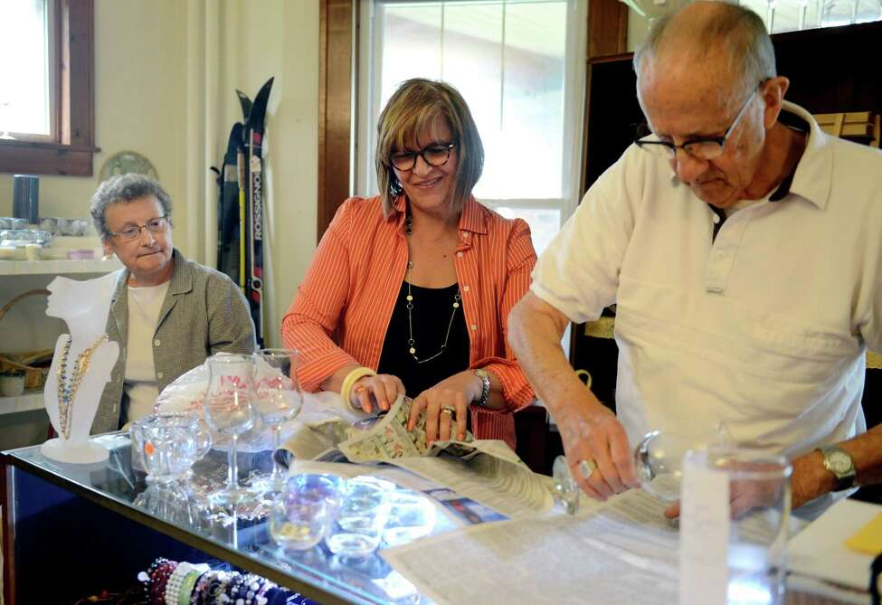 Volunteers Mary Scicchitano, Anna Barletta, and Lou Maganzin package glasses on Tuesday, July 2, 2019, at A Second Chance Thrift Shop in Colonie, N.Y. (Catherine Rafferty/Times Union)