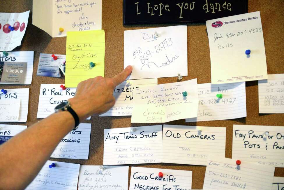Theresa Viva, manager at A Second Chance Thrift Shop, points to requests on the wish board on Tuesday, July 2, 2019, in Colonie, N.Y. Customers who come into the shop can leave their name and what they are looking for so Viva can keep an eye out for it in the donations. (Catherine Rafferty/Times Union)