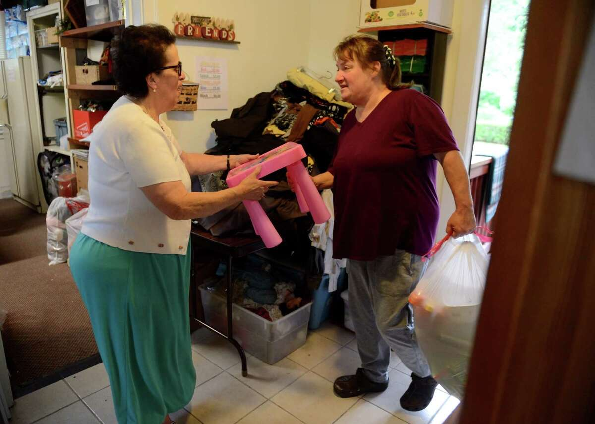 Theresa Viva, manager at A Second Chance Thrift Shop, left, accepts donations on Tuesday, July 2, 2019, in Colonie, N.Y. Viva donates all the proceeds from the shop to the American Italian Heritage Museum next door to preserve her past and help the community. (Catherine Rafferty/Times Union)