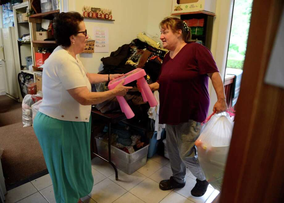 Theresa Viva, manager at A Second Chance Thrift Shop, left, accepts donations on Tuesday, July 2, 2019, in Colonie, N.Y. Viva donates all the proceeds from the shop to the American Italian Heritage Museum next door to preserve her past and help the community. (Catherine Rafferty/Times Union) Photo: Catherine Rafferty, Albany Times Union / 20047383A