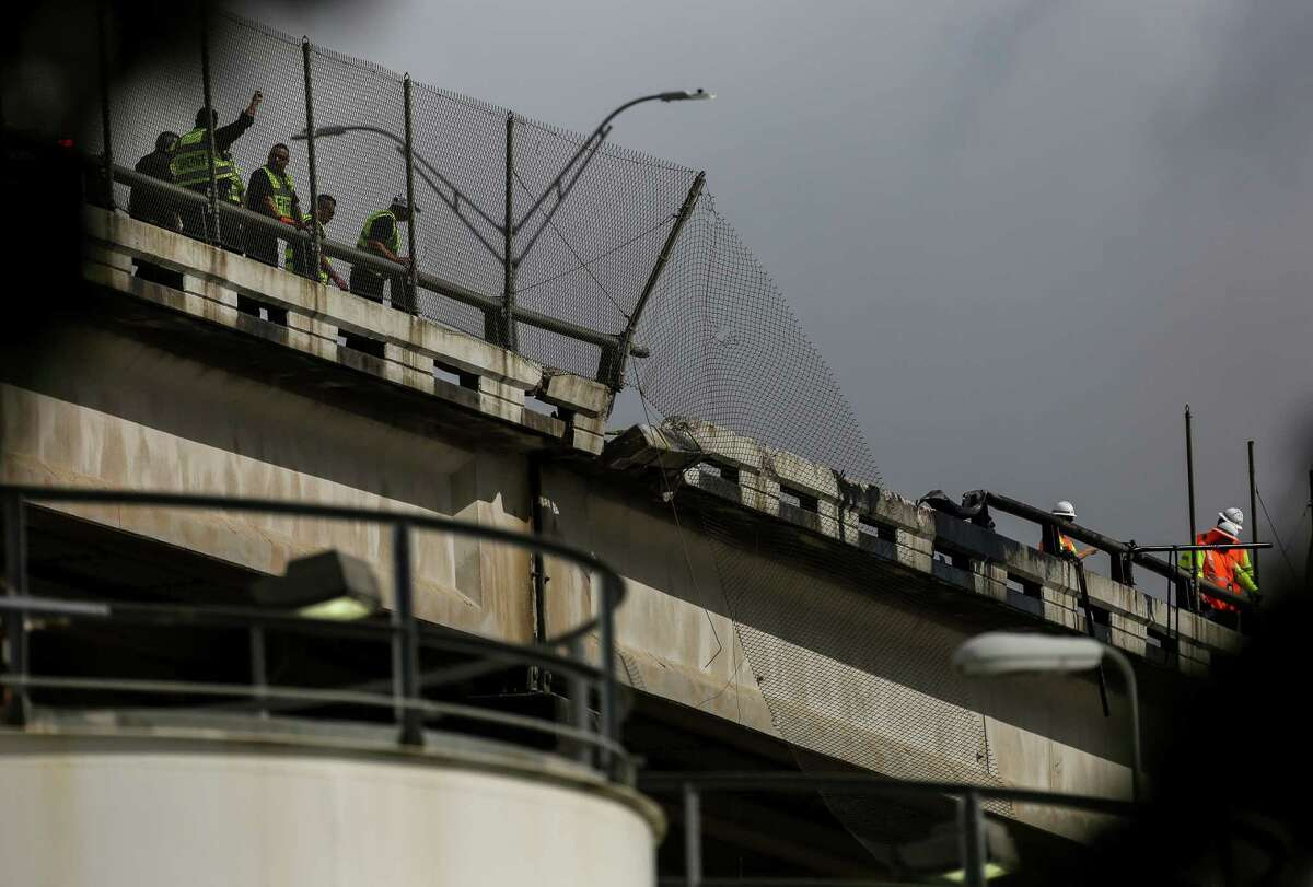Houston Police and Fire departments respond to a scene where an 18-wheeler drove off the Sidney Sherman Bridge 610, and fell onto Concrete Street below Wednesday, July 3, 2019, in Houston.