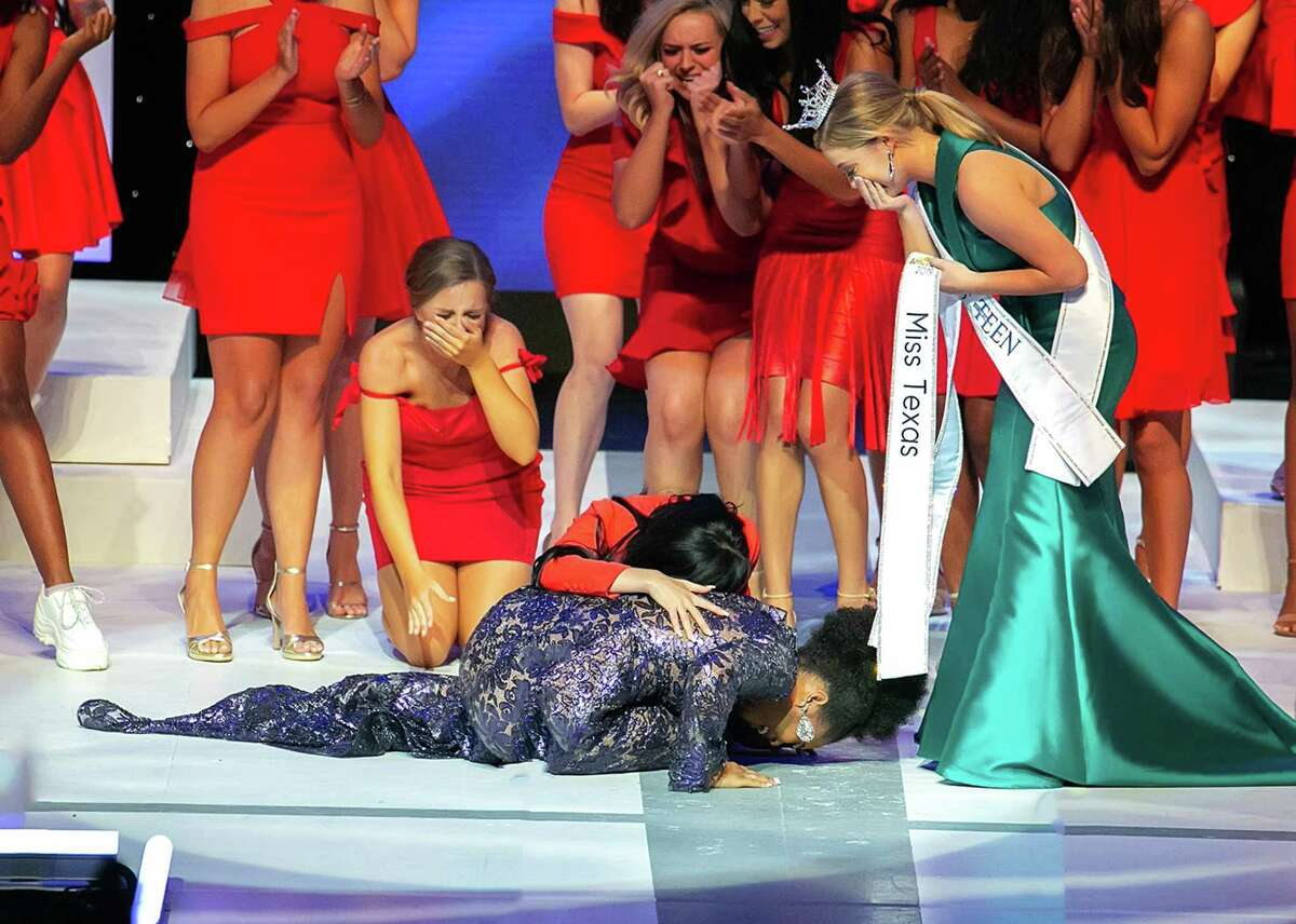 Foreman drops to the floor after learning she is Miss Texas 2019 at the 84th annual state pageant.