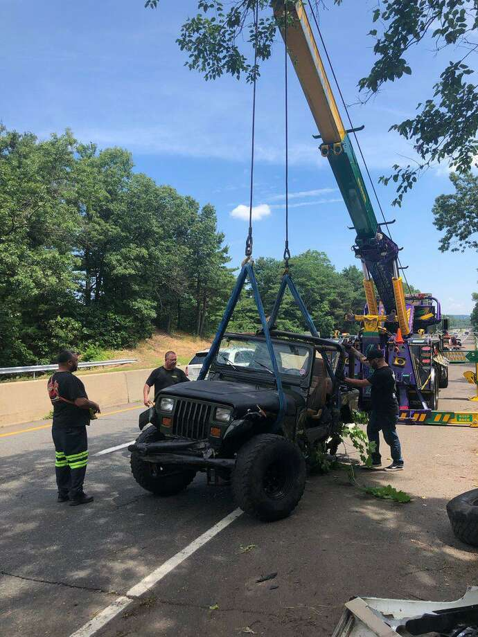 A 19-year-old man was hospitalized after crashing his Jeep on Route 15 in Hamden, according to fire officials. Photo: Hamden Fire Department
