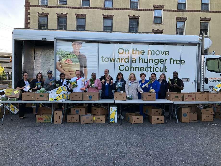 Staff of the Connecticut Food Bank's mobile pantry, which was scheduled visit Bridgeport Hospital throughout summer 2019. Photo: Contributed / Bridgeport Hospital