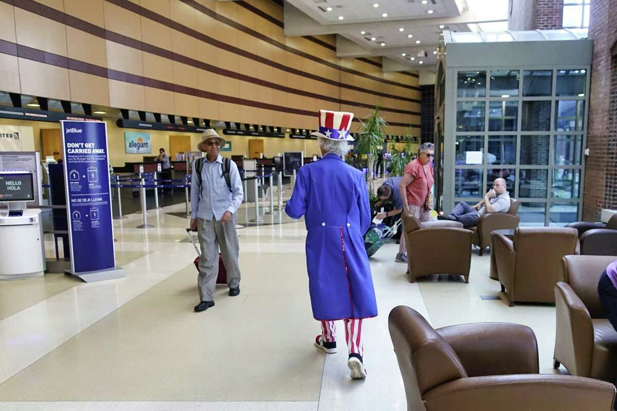 Fred Polnisch portrays Uncle Sam as he strolls through the Albany International Airport greeting travelers on Wednesday, July 3, 2019, in Colonie, N.Y. (Paul Buckowski/Times Union)