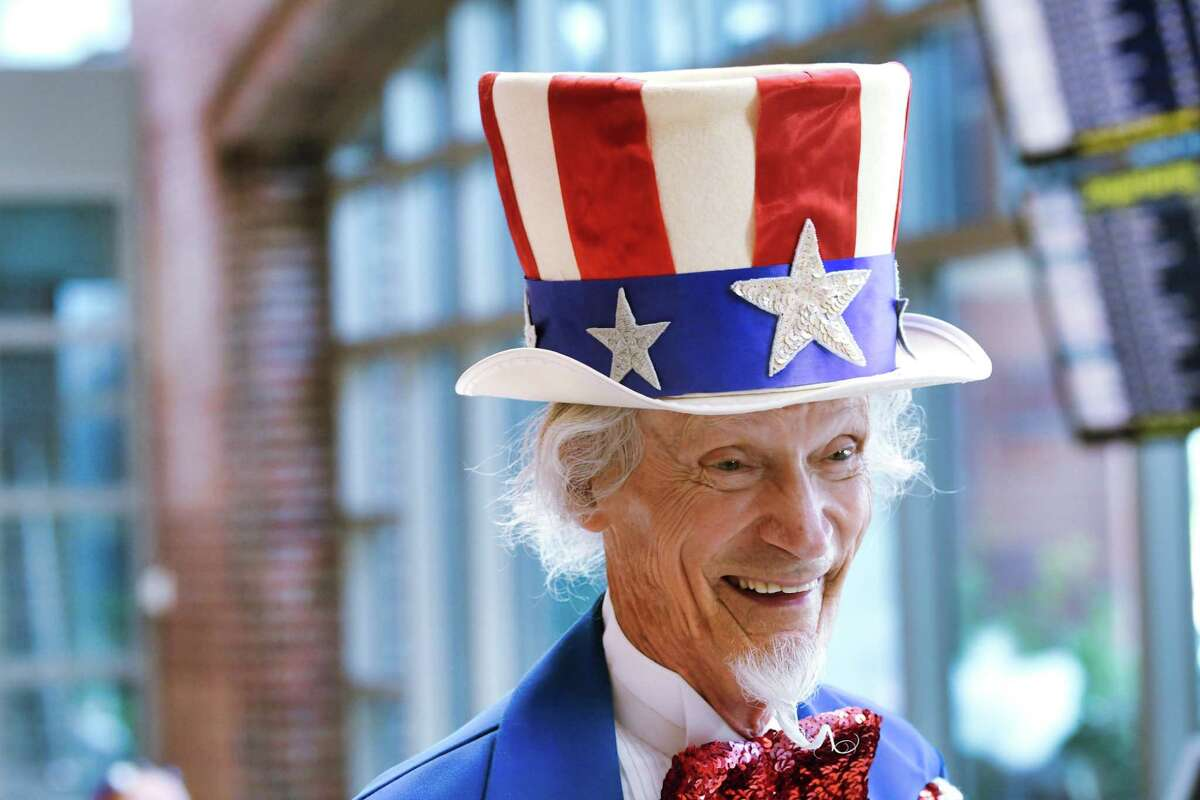 Fred Polnisch portrays Uncle Sam as he talks with travelers at the Albany International Airport on Wednesday, July 3, 2019, in Colonie, N.Y. (Paul Buckowski/Times Union)