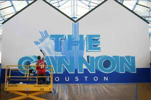 Erik Del Rio works on a mural at The Cannon's new location in West Houston, Monday, July 1, 2019. The new location will be 120,000 square feet.