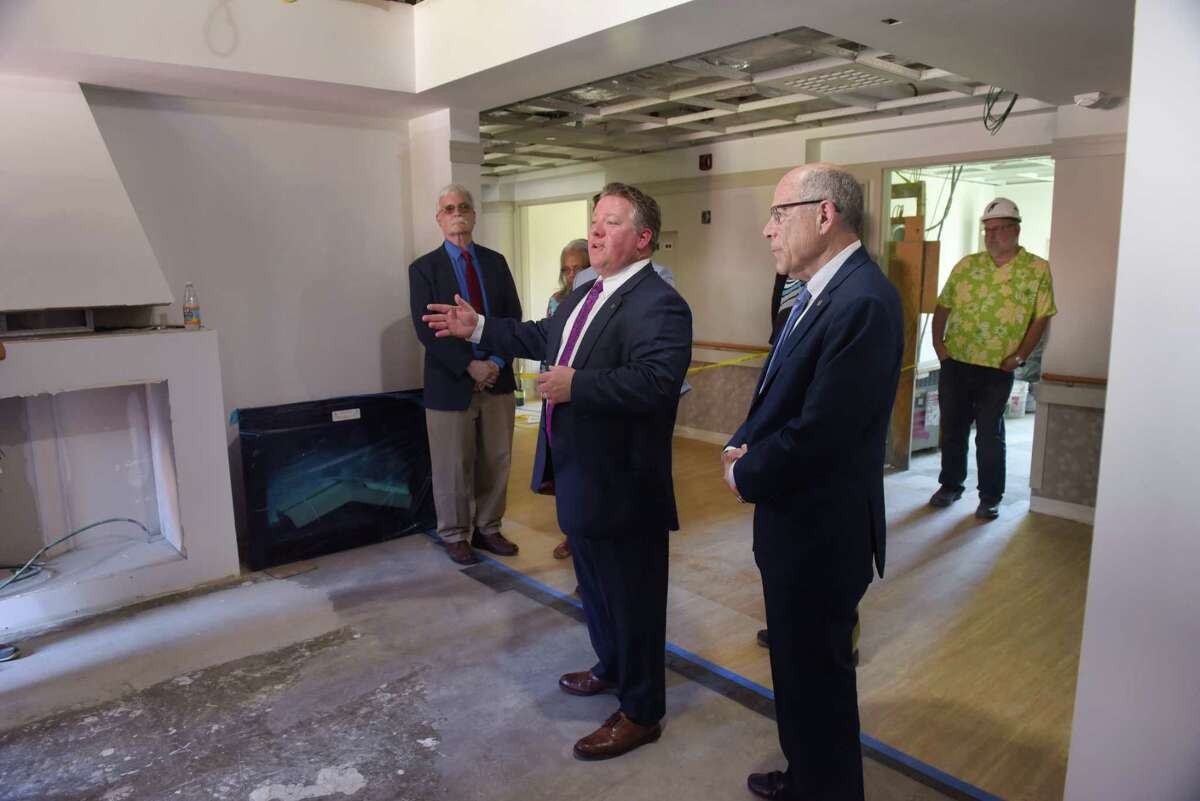 Albany County Executive Daniel McCoy, left, and Larry Slatky, Albany County Nursing Home executive director, lead a tour of a renovation project at the nursing home facility on Wednesday, July 3, 2019, in Albany, N.Y. The nursing home is going through a renovation and new construction project. (Paul Buckowski/Times Union)