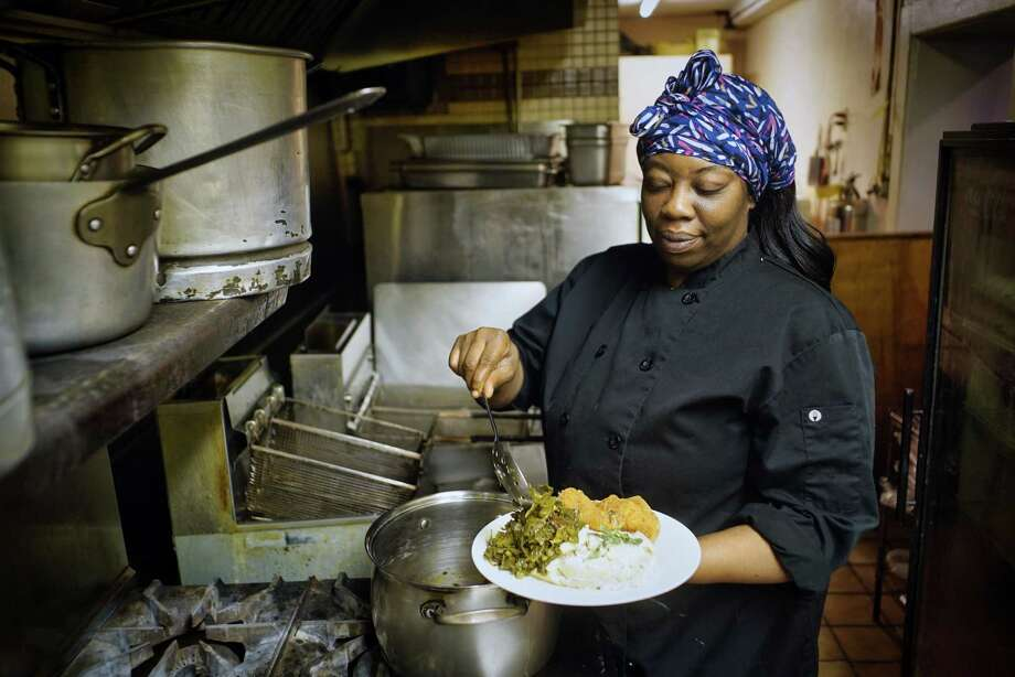 Kizzy Williams, owner of Allie B's Cozy Kitchen, puts collard greens on a plate in the kitchen on Tuesday, June 11, 2019, in Albany, N.Y.   (Paul Buckowski/Times Union) Photo: Paul Buckowski / (Paul Buckowski/Times Union)