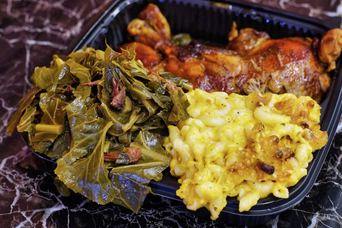 A view of cooked chicken, macaroni and cheese, and collard greens at Kitchen 216, on Tuesday, June 11, 2019, in Albany, N.Y. (Paul Buckowski/Times Union)