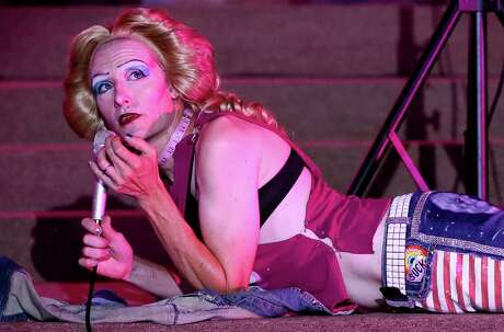 """Roy Thomas stretches out onstage during a rehearsal for """"Hedwig and the Angry Inch"""" at Woodlawn Pointe. Thomas plays Hedwig, the victim of a botched sex change operation, in the show."""