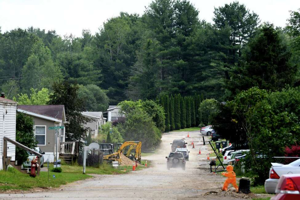 View inside the Kayadeross Acres mobile home park showing repair work taking place to the water and sewer system on Wednesday, July 3, 2019, in Ballston Spa, N.Y. The facility got millions to make improvements in 2016. (Will Waldron/Times Union)