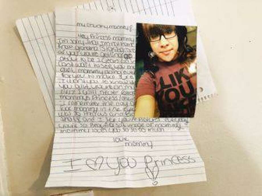 A photo of Tianna Laboy is pinned to a wall at her mother's home along with a letter Tianna penned for her baby. Photo: Contributed Photo / Copyright 2019. All rights reserved.